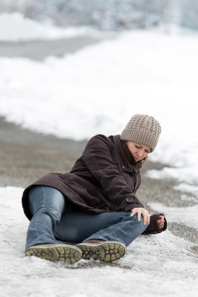 Woman who fell on the ground during winter
