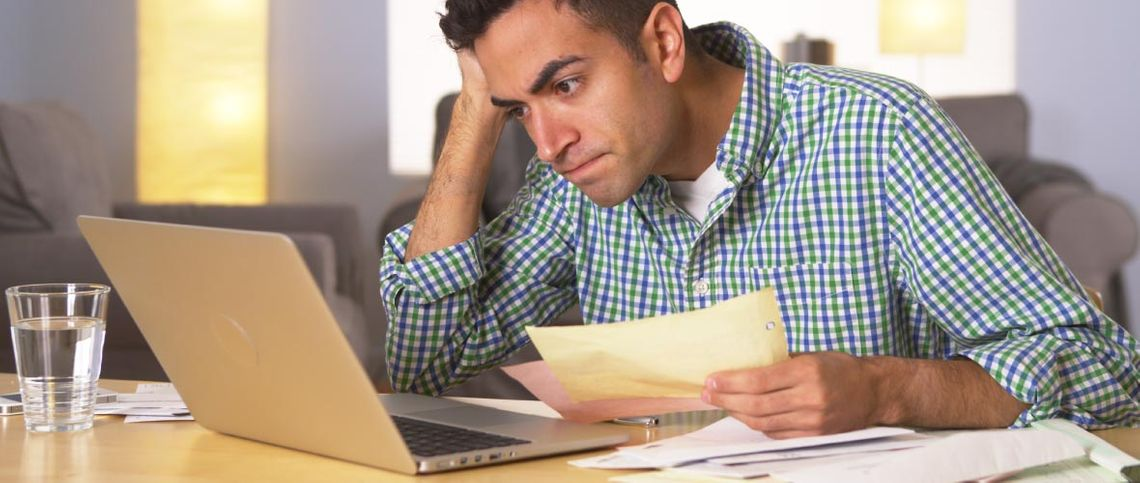 Stressed man looking at his computer